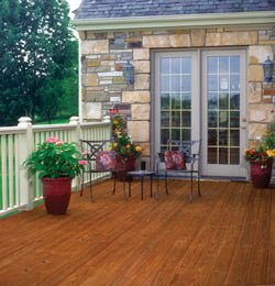 Wood deck with flowers and furniture