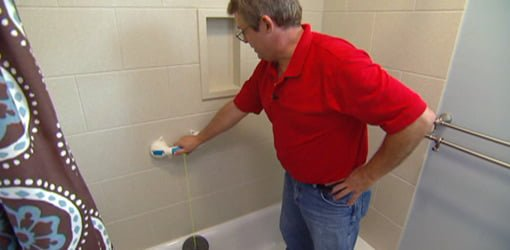 Allen Lyle testing Super Grip Safety Handle in bathroom