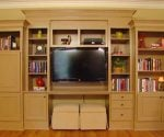 Built-in bookcase painted an beige color similar to the walls