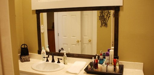 how to add a wood frame to a bathroom mirror todays homeowner
