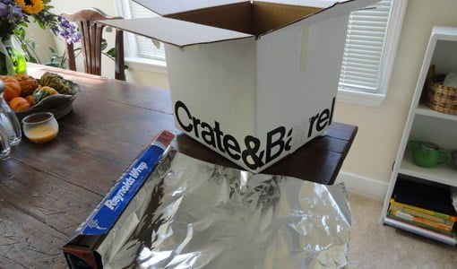 Cardboard box and aluminum foil for Faraday cage.