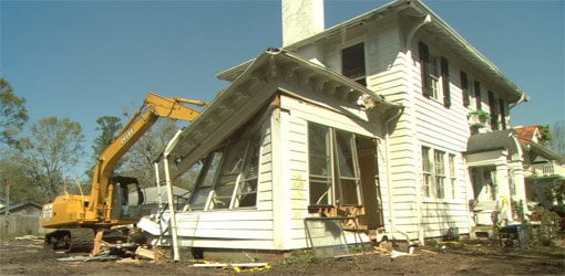 Demolition of old addition on two-story home