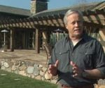 Danny Lipford standing outside eco-friendly green home.