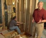 Danny Lipford in gutted master bathroom with Artie the plumber.