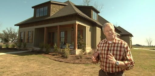 Danny Lipford standing in front of eco-friendly green home.