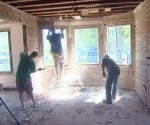 Removing plaster from the Kuppersmith Project house.