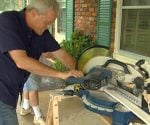 Danny Lipford cutting crown molding on a miter saw.