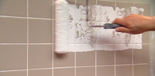 Painting over tile with a roller.