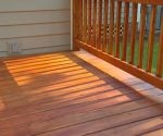 Newly stained wood deck and railing.