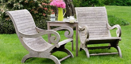 Wood chairs and table on lawn