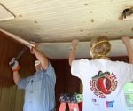 Removing tile ceiling.