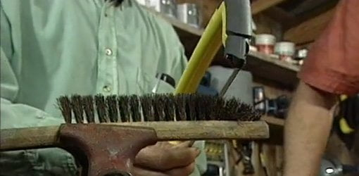 Cutting off the end of an old wire brush to give it new life.
