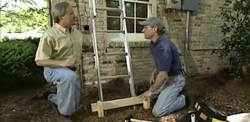 Danny Lipford and Joe Truini with properly braced ladder.