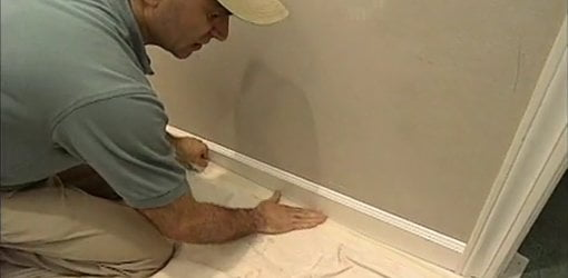 Joe Truini Attaching Masking Tape To Drop Cloth And Trim. To Keep Drop  Cloths Against Walls When Painting A Room: