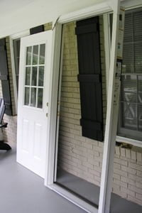 Door removed from frame for painting before installation.