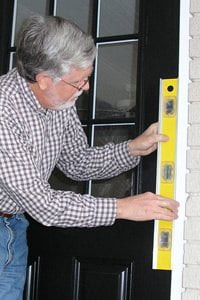 Checking door frame for plumb. & How to Remove and Replace an Entry Door | Todayu0027s Homeowner - Page 6