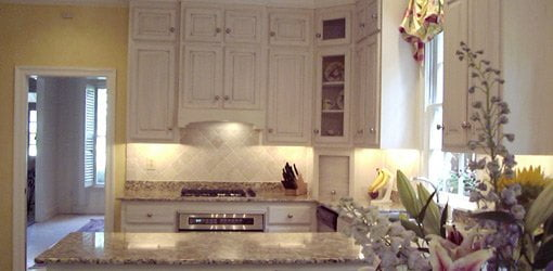Completed upgraded kitchen with granite countertops and tile backsplash.