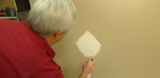 how to fix a hole in a plaster wall video