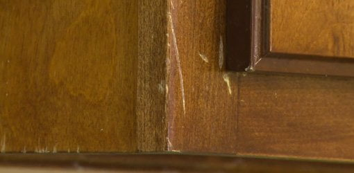 Captivating Unsightly Scratches On Stained Wood Cabinets Before Repair.