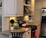 Kitchen with gas stove and range hood.