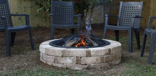 Completed backyard fire pit built from a kit. - How To Build A Backyard Fire Pit From A Kit Today's Homeowner