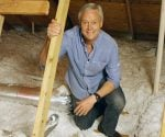 Danny Lipford in attic with vent pipe form bathroom exhaust fan.