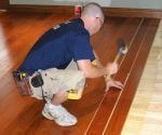Installing hardwood flooring over a radiant heating system.