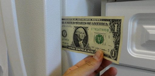 Using a dollar bill to test the seal on your fridge.