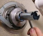 Using special locknut and basket wrenches to remove a sink strainer.