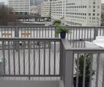 Completed rooftop composite deck and railings.