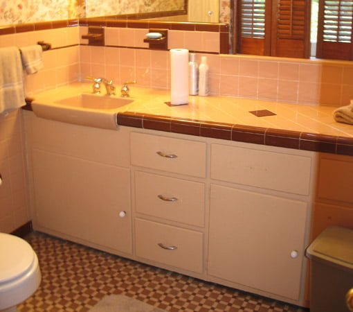 Tile vanity top with plywood cabinet.