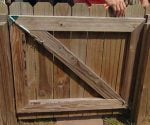 Anti-Sag Gate Kit installed on wooden fence gate to prevent sagging.