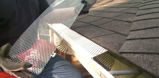 Installing gutter guard covers.