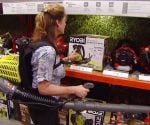 Jodi Marks with gas powered Ryobi backpack leaf blower.