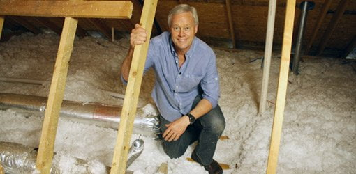 Danny Lipford checking insulation in home's attic.