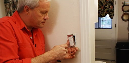 Danny Lipford installing a dimmer switch.