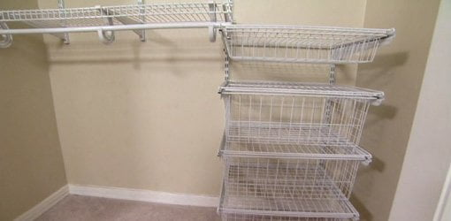 Wire baskets and shelves in closet.