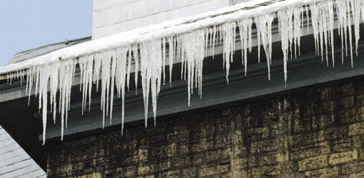 Icicles on eave of house.