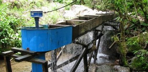 Microhydropower system turning flowing water into electricity.