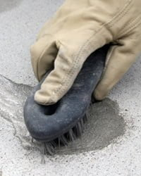 Cleaning concrete.