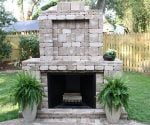 Pavestone outdoor paver fireplace.