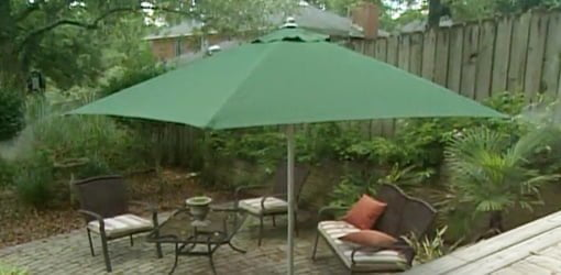 Shade umbrella with built-in water mister.