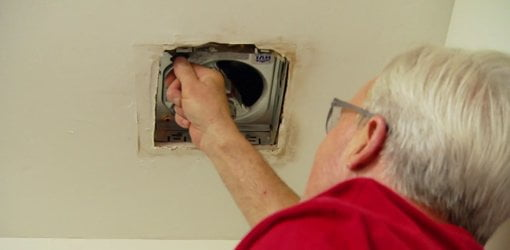 Danny Lipford installing bathroom vent fan.