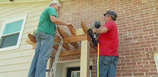 Attaching a shade arbor to a brick wall.