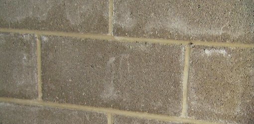 Removing efflorescence from concrete block walls today 39 s for Best way to remove stains from concrete