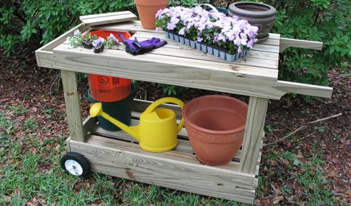 Combination potting bench and garden cart.