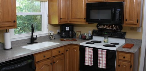 Delicieux Remodeled Kitchen With New Solid Surface Countertops And Faucet.