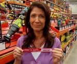 Jodi Marks holding Diablo Steel Demon reciprocating saw blade in Home Depot store.
