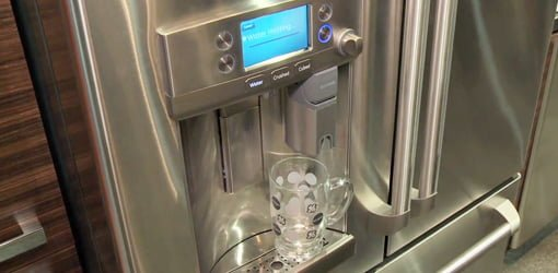 Keurig dispenser on GE refrigerator.