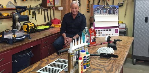 Danny Lipford in workshop with caulking, glue, and  other products.